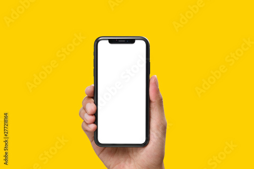 Leinwand Poster  Hand holding the black smartphone with blank screen and modern frame less design
