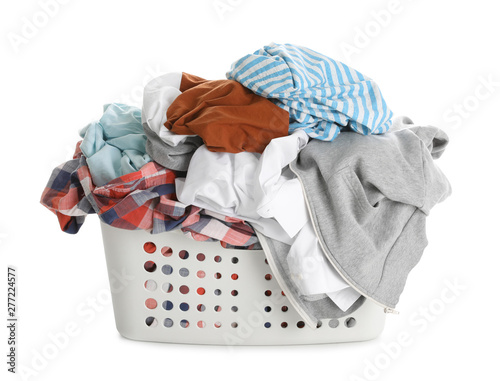 Basket full of dirty laundry isolated on white Canvas-taulu