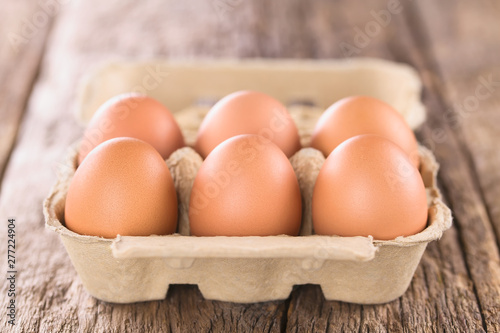 obraz PCV Raw brown eggs in egg box or carton (Very Shallow Depth of Field, Focus on the front of the first eggs)
