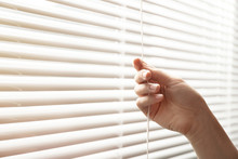 Woman Opening Window Blinds, Closeup. Space For Text