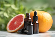 Bottles Of Essential Oil And G...