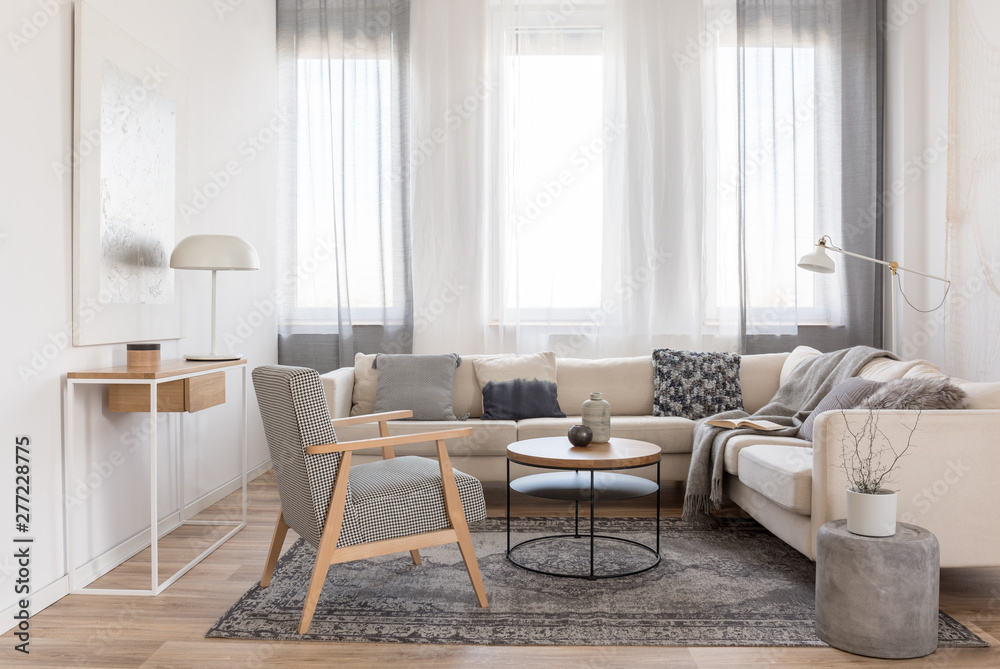 Fototapety, obrazy: Round wooden coffee table in front of scandinavian corner sofa with pillows