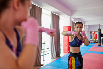 Boxer girl shadow boxing