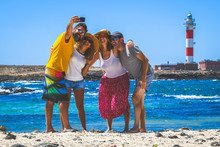 Happy Friends Taking Selfie With Smartphone At The Beach Lighthouse In Background Young People Having Fun Together During Tropical Vacation On An Exotic Island Youth Lifestyle Happiness Travel Concept