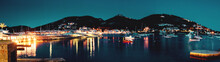 Night Scene Panorama View Of The Idyllic Harbor With Boat And Restaurants And The Mountain In The Background.Port D' Andratx, Port Andratx, Mallorca Spain Balearics