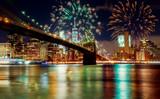 Fototapeta Nowy Jork - New York City's Brooklyn Bridge and Manhattan skyline illuminated amazing fireworks in Independence day
