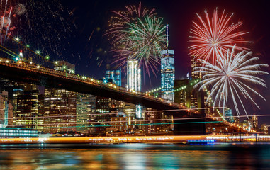 Colorful holiday fireworks panoramic view New York city Manhattan downtown skyline at night