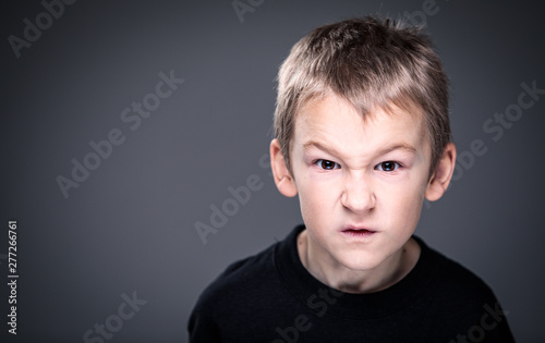 Fotografie, Obraz  Loads of aggression in a little boy - education concept hinting behavioral probl