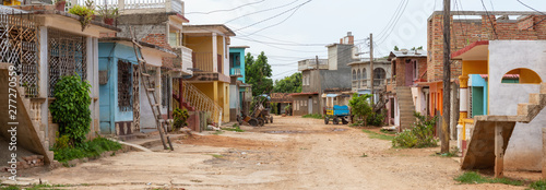 Panoramic Street View of a small Cuban Town during a vibrant sunny day Wallpaper Mural