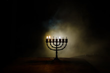Low Key Image Of Jewish Holiday Hanukkah Background With Menorah On Dark Toned Foggy Background