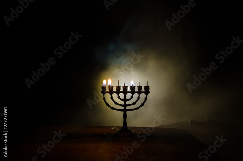 Low key image of jewish holiday Hanukkah background with menorah on dark toned f Wallpaper Mural
