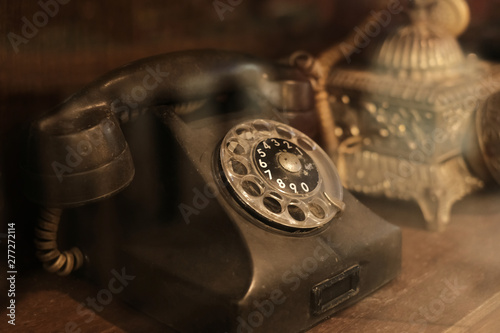 Poster Pays d Asie collectibles and decoration - Classic and old telephone reciever. retro technology. vintage color tone.