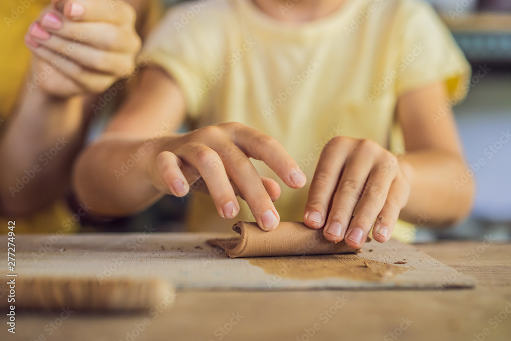 Fototapety, obrazy: mother and son doing ceramic pot in pottery workshop