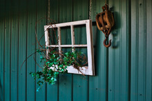Country Style Decoration Outside Poll Barn At Golden Hour Including Window Pain, Ivy And Pulley Hook