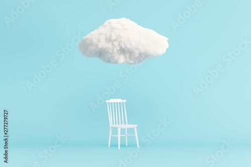 Foto  Cloud Floating above white chair on blue background