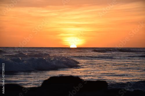 Tropical glowing orange Hawaiian sunset