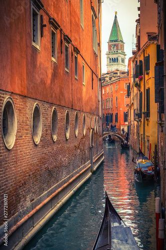 Fotografie, Obraz  Gondolas on narrow canal in Venice