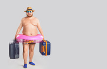 A Fat Man In A Swimsuit With S...