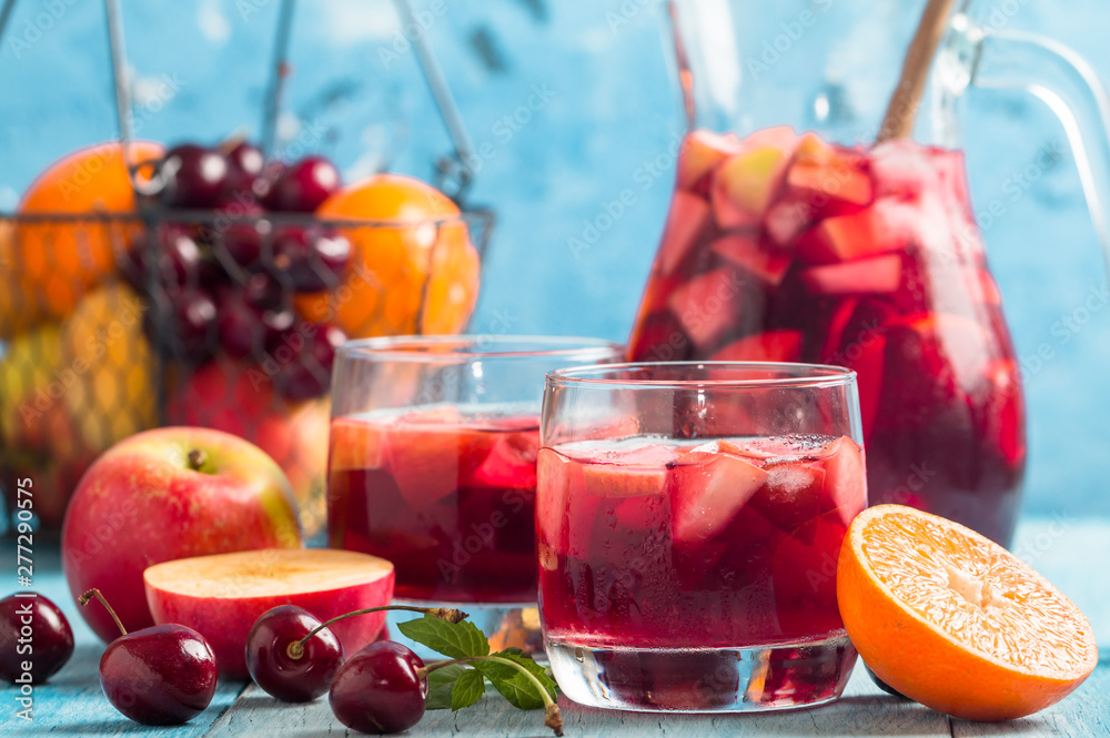 Fototapety, obrazy: Refreshing sangria or punch with fruits in glasses and pincher