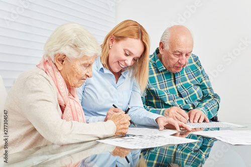 Woman and two seniors are doing memory training