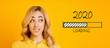 Leinwanddruck Bild - Blonde biting her lip and looking at 2020 loading process