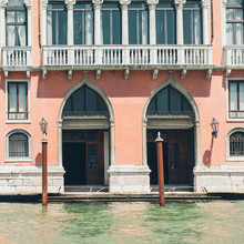 Venice Grand Canal (Canal Grande). Beautiful Ancient Architecture And Gondolas. Window And Doors On Red Wall.