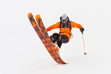 Professional Skier Athlete Rides Out Of Deep Snow While Performing A Skiing Trick In A Snowstorm. The Winter Season Is A Good Powder Day. Winter Extreme Sports