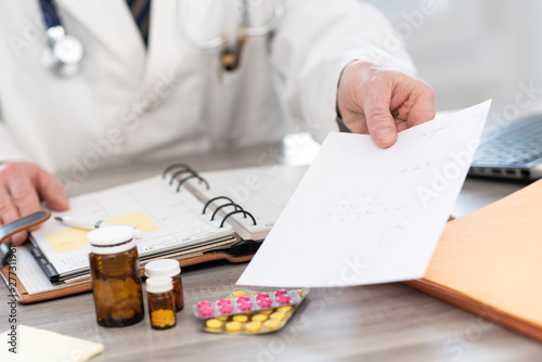 Hand of doctor giving a prescription