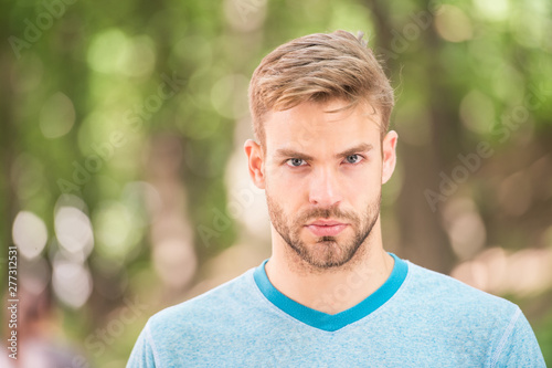 Fototapeta Charming confidence. Blond man. Man with unshaved mustache and beard hair with stylish haircut. Handsome man in casual tshirt on blurred natural background. Caucasian man on summer day obraz