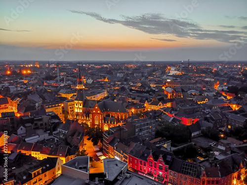 Foto auf Leinwand Rosa dunkel Hasselt city center aerial view shortly after sunset, Limburg province, Belgium