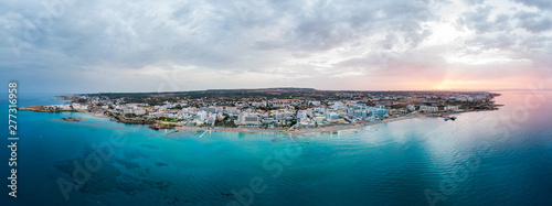 Spoed Foto op Canvas Cyprus Aerial drone shot of Protaras city at sunset