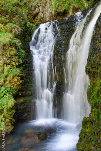 Tuinposter Watervallen First waterfall of the Enna river springs. Val Taleggio