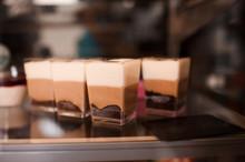 Chocolate Cakes In Show Window Closeup.