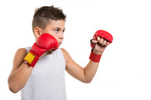 Karate Boy In Fighting Stance Concentrates On His Hands Red Gloves, On A White Background