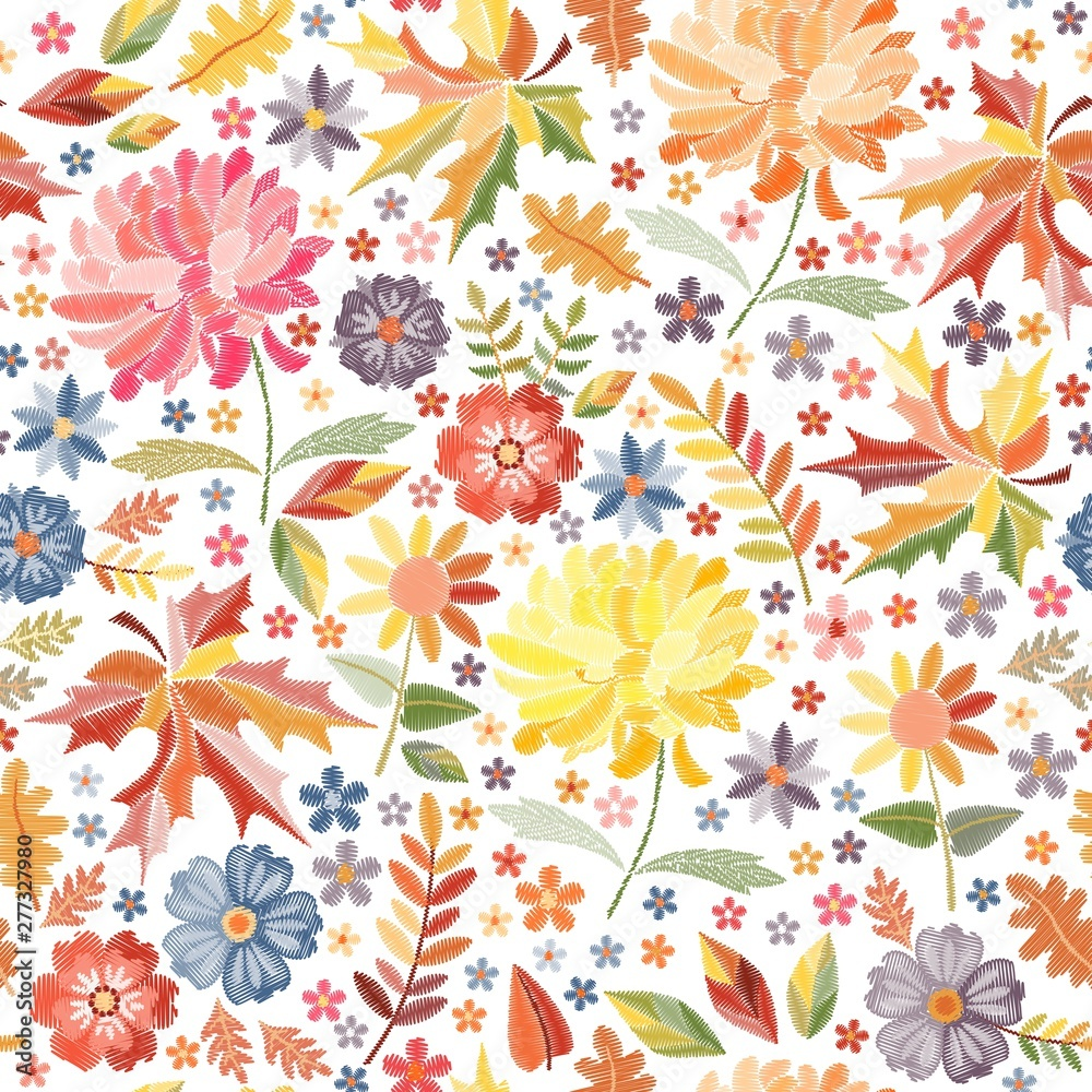 Bright embroidery with autumn flowers and leaves on white background. Colorful seamless pattern with embroidered print.