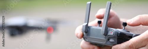 Fotografía Modern video recording drone controlled with male hands holding remote controlle