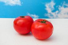 トマトと青空  Red Freshly Picked Tomatoes