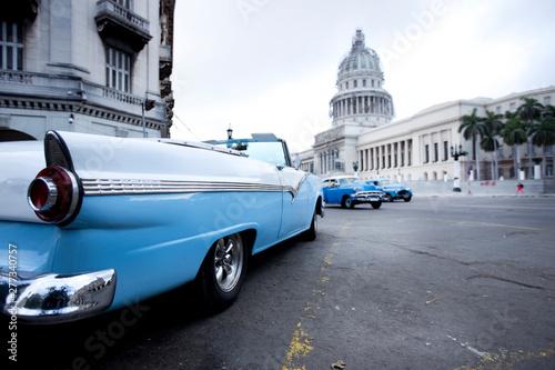 Old American blue car in the Paseo de Marti in Old Havana in Cuba near the Capit Fototapeta
