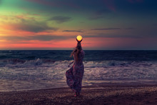 The Girl Holds The Moon In Her...