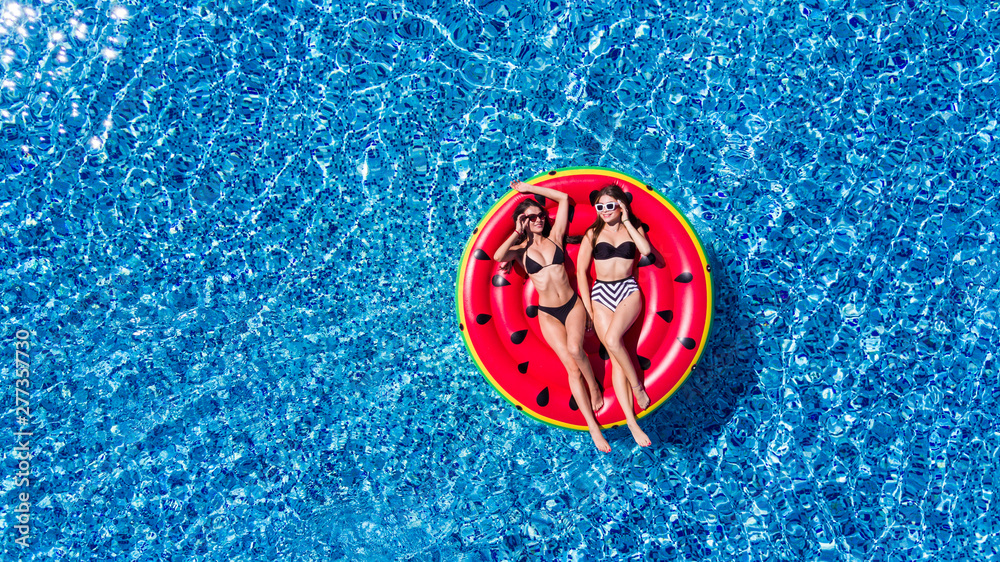 Fototapety, obrazy: Aerial view of young pretty woman lying on inflatable watermelon mattrass floating and relaxing in swimming pool. Summer vocation.