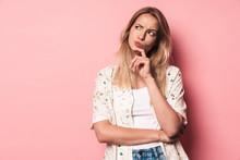 Thinking Displeased Young Blonde Cute Girl Posing Isolated Over Pink Wall Background.