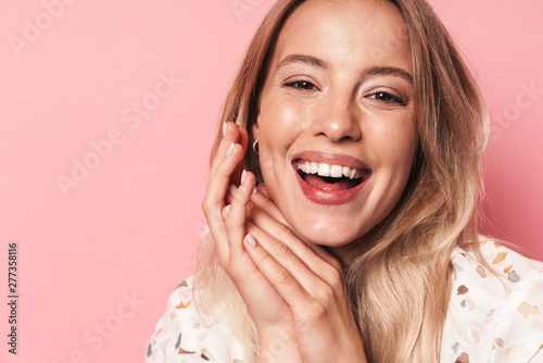 Deurstickers Snelle auto s Happy young blonde cute cheery girl posing isolated over pink wall background.