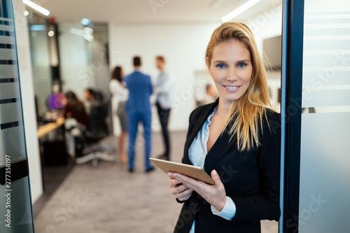 Deurstickers Snelle auto s Attractive businesswoman using digital tablet in office