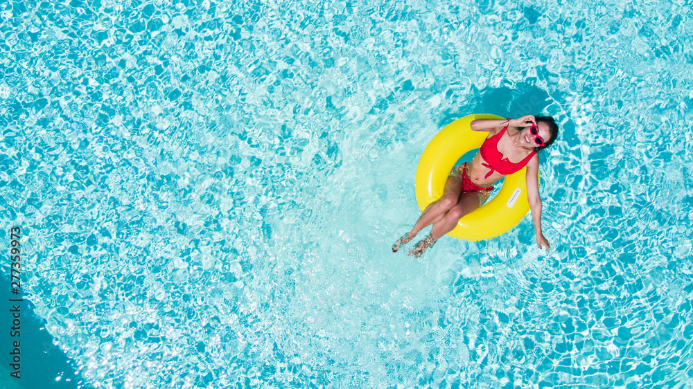Fototapety, obrazy: Happy young woman in bikini with rubber inflatable float, playing and having a good time at water fun park pool, on a summer hot day