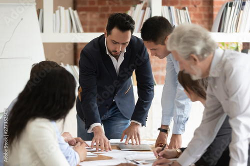 Fototapety, obrazy: Multiethnic business team people with male boss manager discuss paperwork