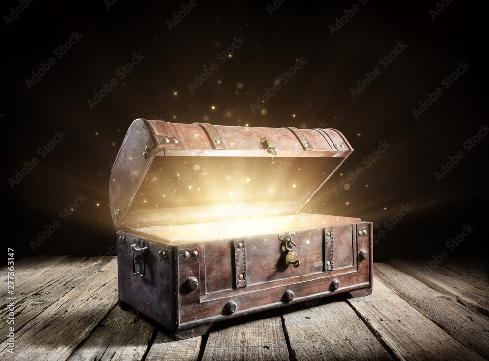 Fototapeta Treasure Chest - Open Ancient Trunk With Glowing Magic Lights In The Dark
