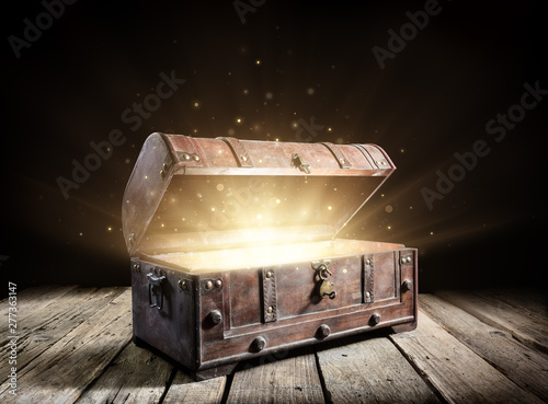 Fotografie, Obraz Treasure Chest - Open Ancient Trunk With Glowing Magic Lights In The Dark