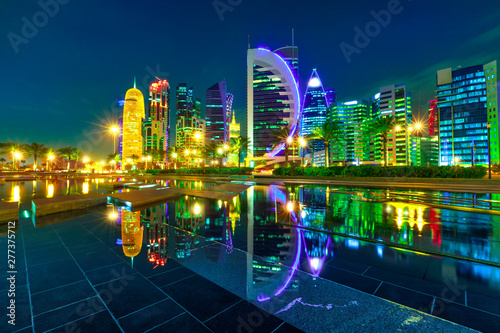 Fényképezés  The colorful towers of Doha West Bay reflection by night