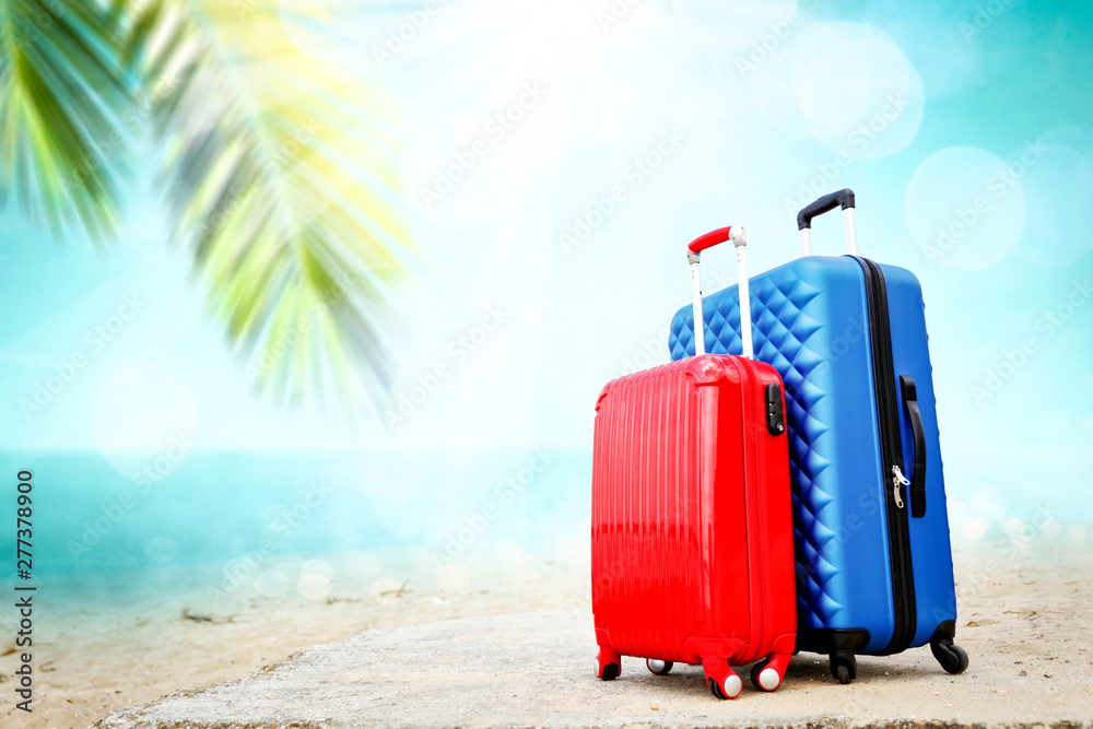 Fototapety, obrazy: Summer suitcase on beach and free space for your decoration.