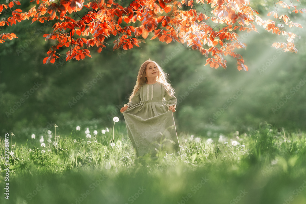 Fototapety, obrazy: Full Length shot of small girl looking up to the sun lights in the park